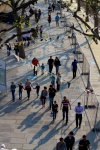 People walking beneath bunting in the late afternoon sun on the south bank, London