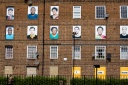 Faces of people who used to live at a condemned estate, art project