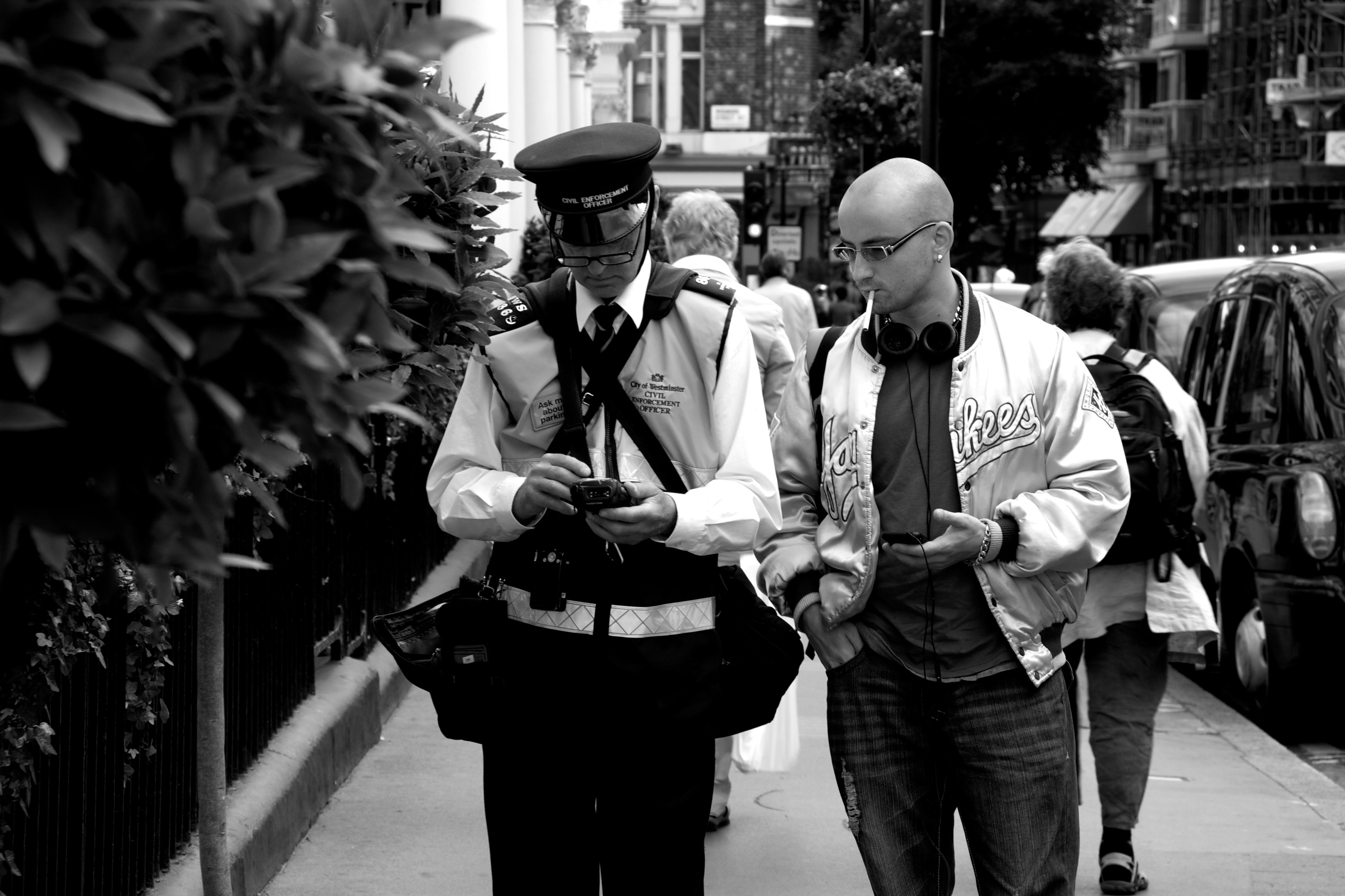 Man receives parking ticket on a London Street