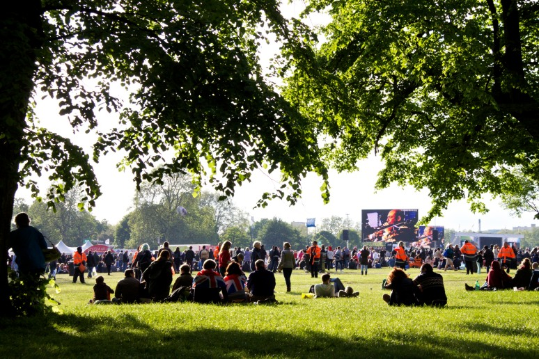 Picknickers enjoy the evening sun while watching the Diamond Jubilee concert on the big screen in Hyde Park, London