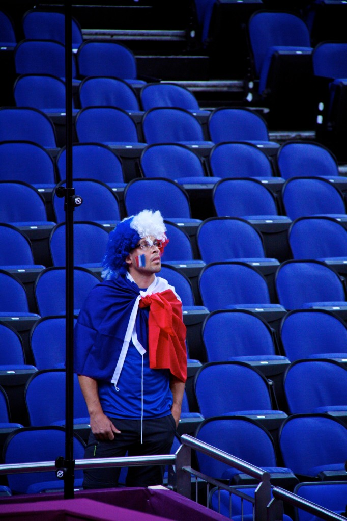A lone French fan waits for the wheelchair basketball to start at the North Greenwich Arena at London 2012