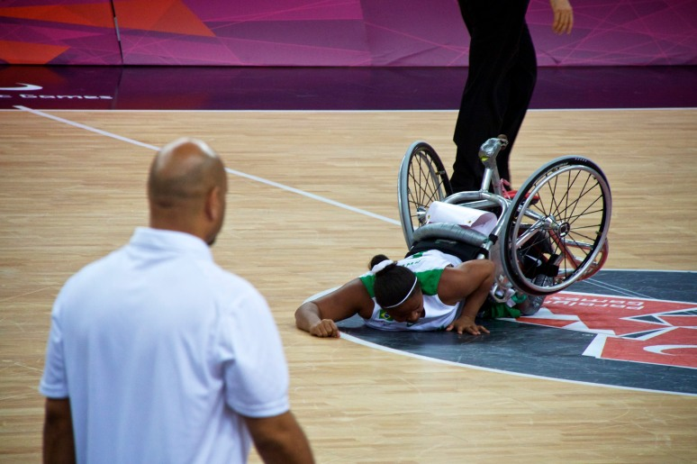 Player falls to the floor in wheelchair basketball game