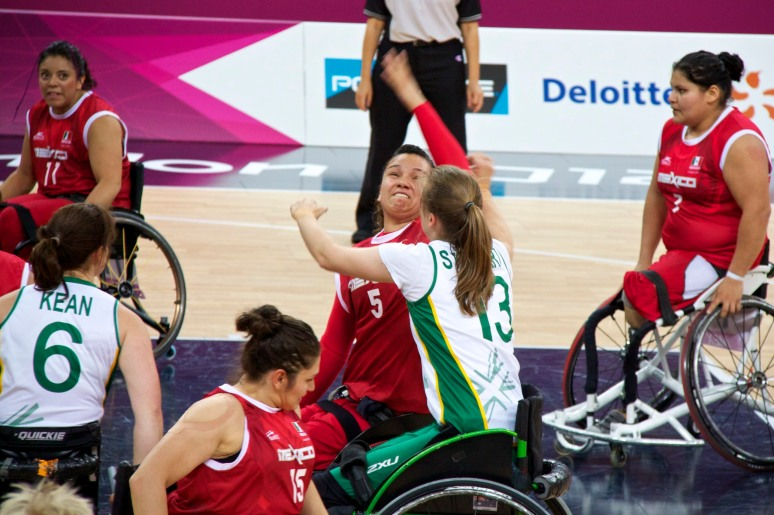 Mexico and Australia go for the ball at wheelchair basketball game at London 2012