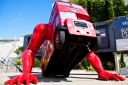 A big red bus does push ups outside Czech headquarters in London during Olympics 2012