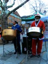 Man and woman steel band, man dressed in Father Christmas suit