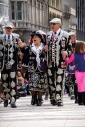 Pearly Kings and Queens singing along to a song while parading