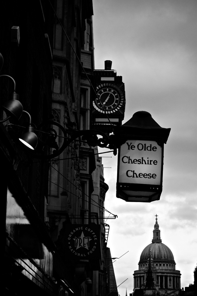 Ye Olde Cheshire Cheese sign and St Paul's dome on Fleet Street, London