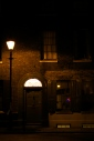 A light above a door and street light in Spitalfields, east London