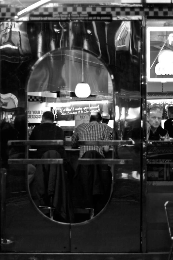 Looking through the door of Ed's Diner on Old Compton Street, Soho, London