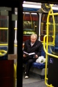 A man on a bus reading a book