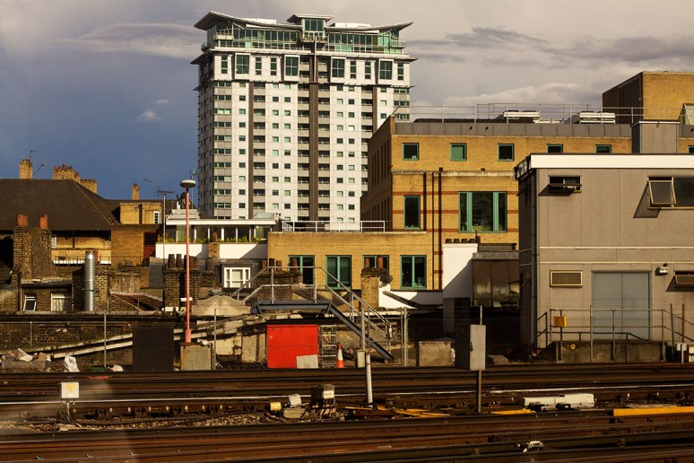 Buildings and rail lines in evening sun
