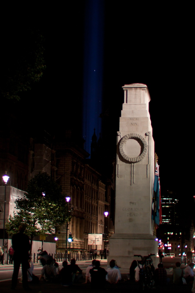 The Cenotaph and the beam of light from Parliament
