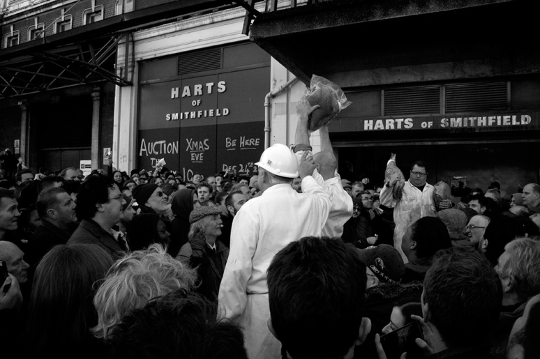 Harts Butchers selling meat to the crowd at the meat auction at Smithfield on Christmas Eve 2014