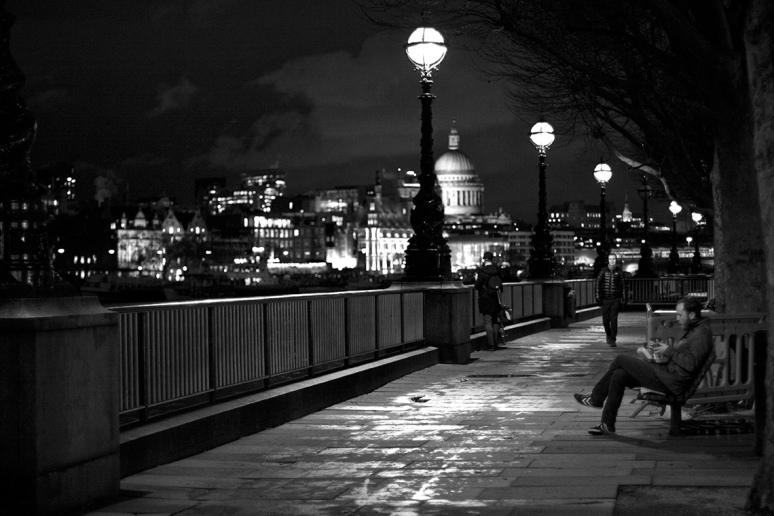 People alone on the South Bank with St Paul's in the background