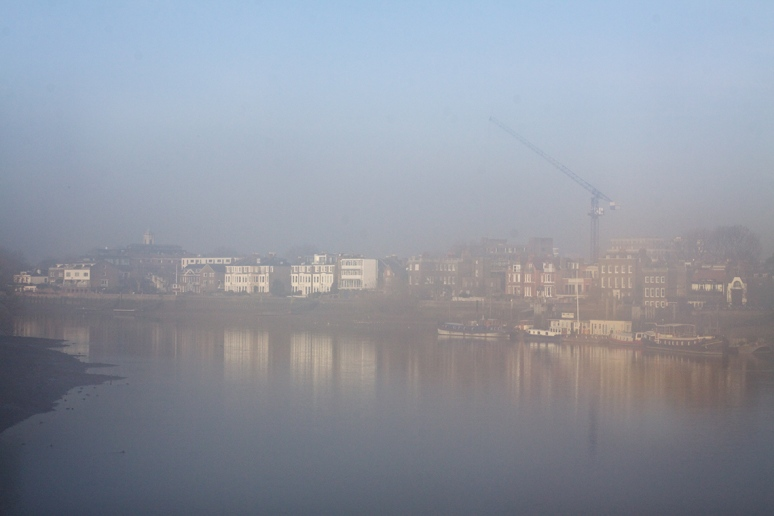 A view across the Thames from Hammersmith Bridge, taken through the mist of a bus window
