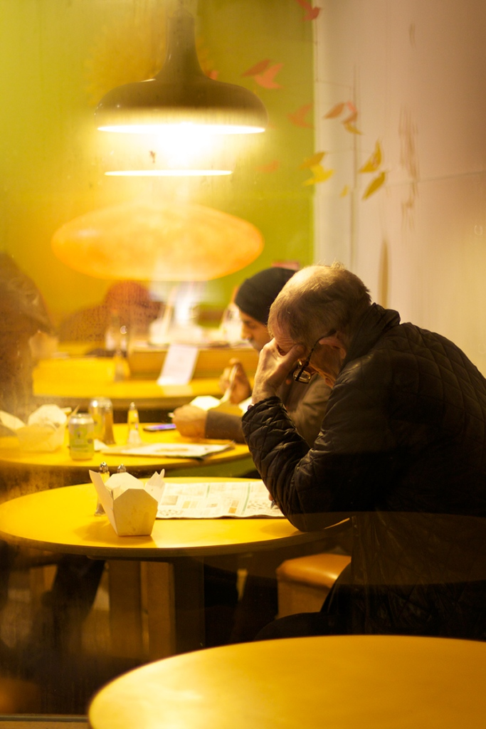 Man sitting in a cafe in Soho, London