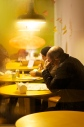 Man sitting in a cafe in Soho, London