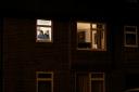 Man in kitchen window