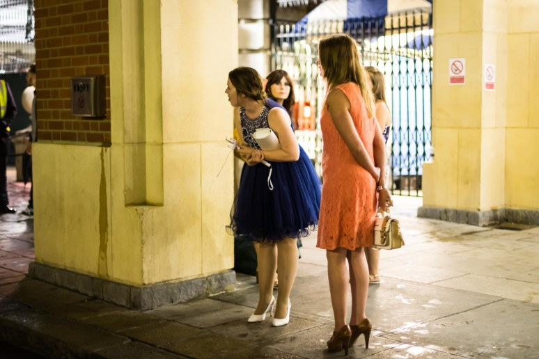 Three women in party outfits in Covent Garden, London