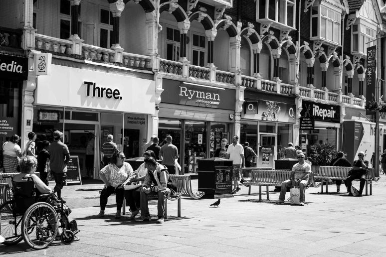 People sitting on benches in Southend town centre