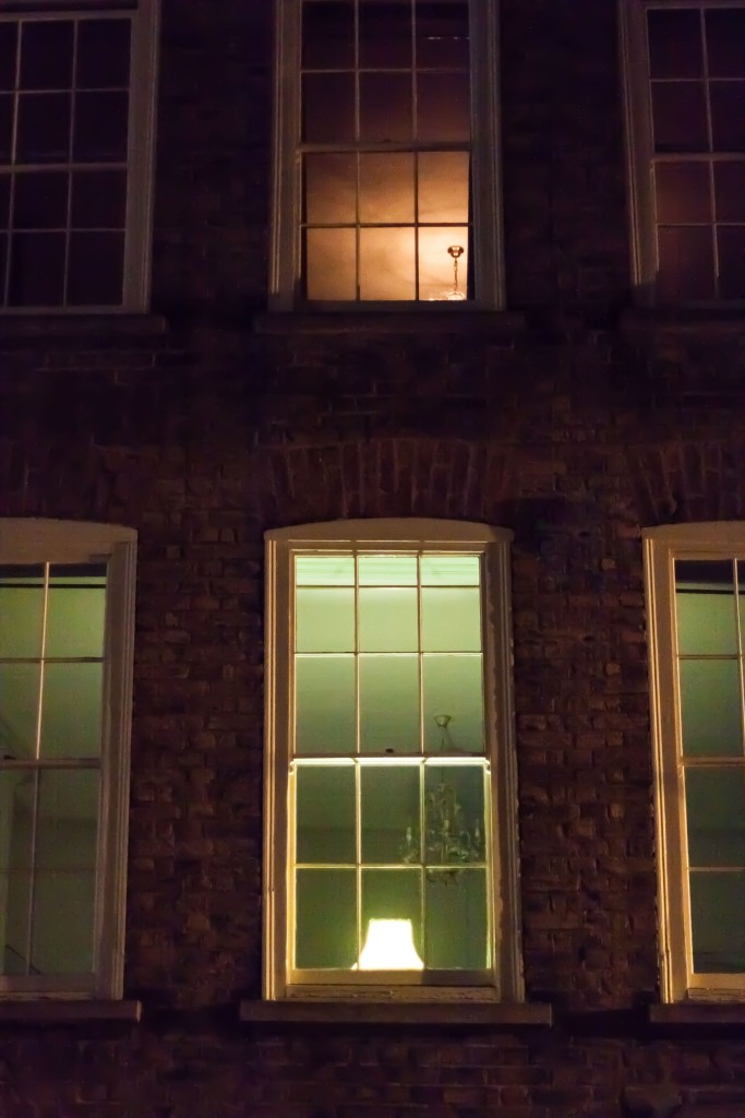 Looking at a lamp and ceilings through Georgian windows in Spitalfields, London