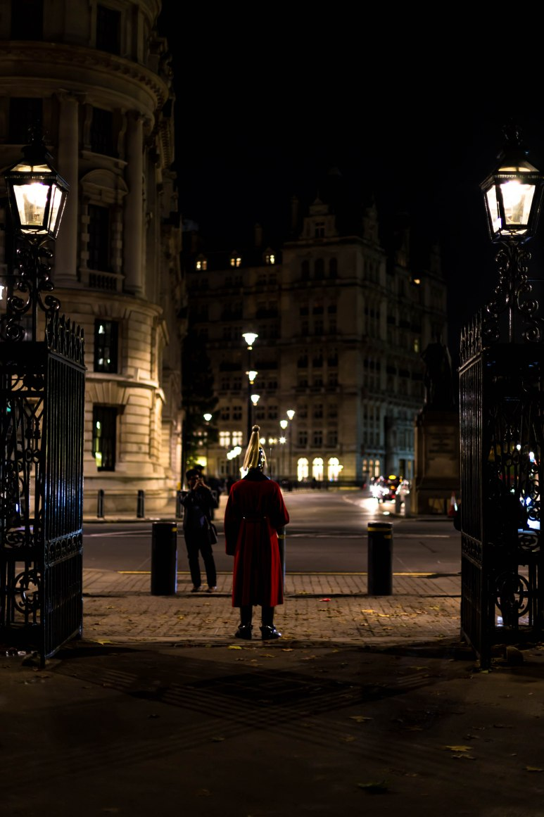 A tourist takes a photo of a member of the Household Cavalry, Horse Guards, London